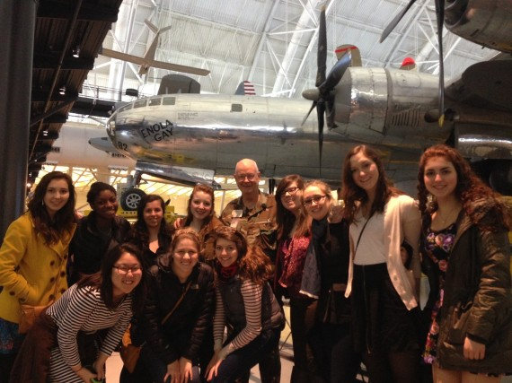 "Benton Scholars with Col. Scott Willey, in front of the B-29 ""Enola Gay"" at the Smithsonian's Air & Space Museum."
