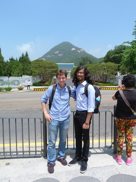 '17 Benton Scholars Zachary Weaver and Ishir Dutta stand for a picture in front of the Blue House, the residence of the President of South Korea.