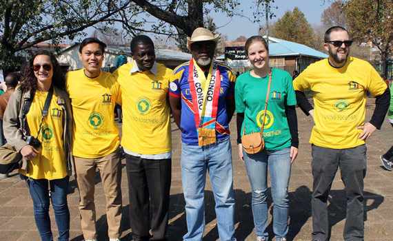 Professor Solomon, student participants and community partners participating in a community pride event in South Africa