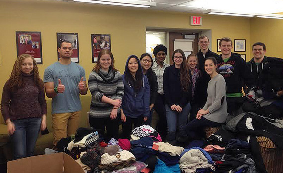 Students sorting clothing collect for the Somali Refugee Center during MLK Week.