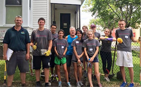 Students pitched in to help Utica residents as part of a first-year pre-orientation program.