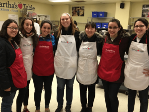 Students volunteering at soup kitchen in Washington DC on Hunger and Homelessness alternative break trip.