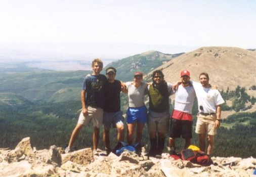 Students pose at a scenic view on a mountaintop