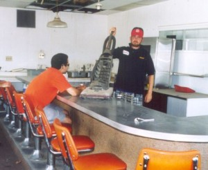 Student places a vacuum cleaner on the counter at a diner