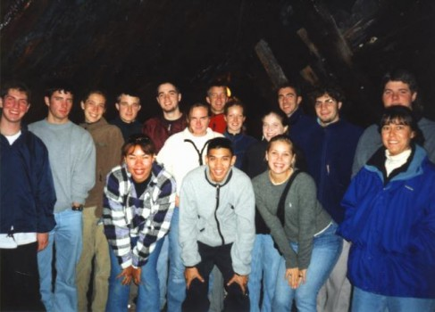 Student group poses for a photo in the coal mine