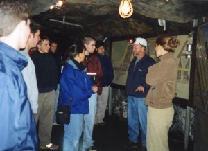 Students listen to cola mine guide