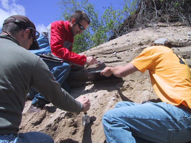 Mike Meredith, Jason Williams, and Bret Doverspike measure dip directions of crossbeds in Pleistocene delta deposits, Caroga Lake NY