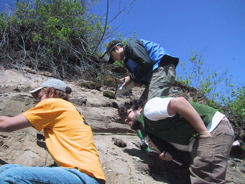 Bret Doverspike, Evan Goldstein, and Drew Koff (top) examine sedimentary structures in sand deposits, near Caroga Lake NY