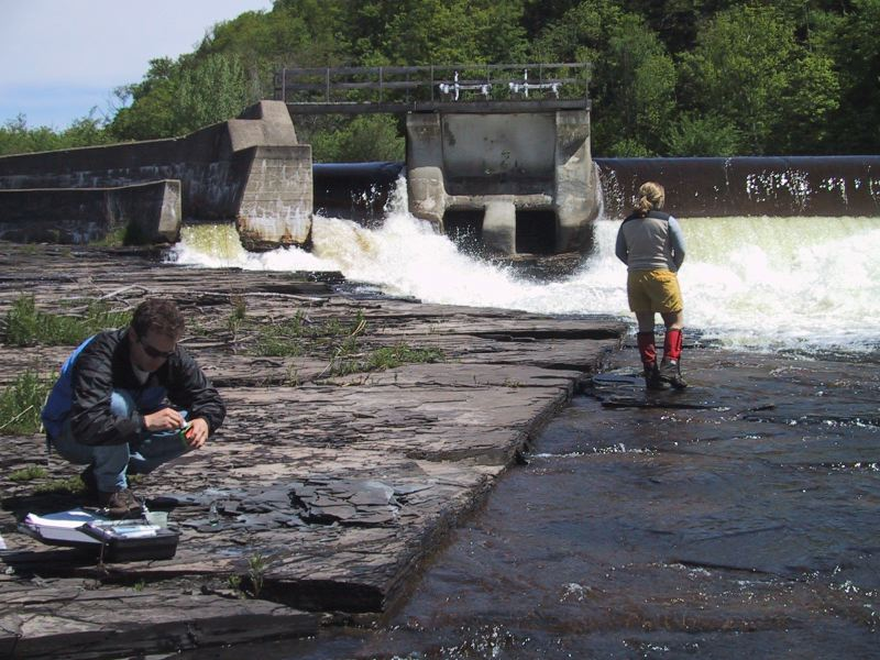 Drew Koff finishes the alkalinity test while Liz Hoekwater get a closer look at the falls, Dolgeville NY