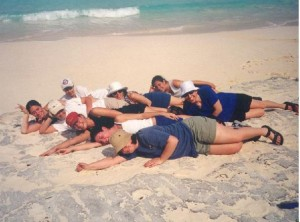 Students laying in the sand