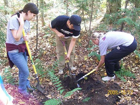 Lauren Idleman, Miguel Rodriguez, and Elin Brown dig a pit to examine Adirondack soils