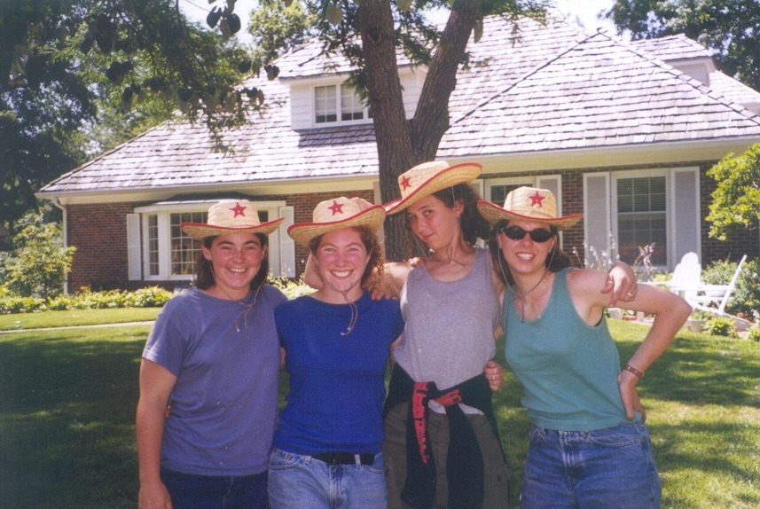 Students pose in children's cowboy hats