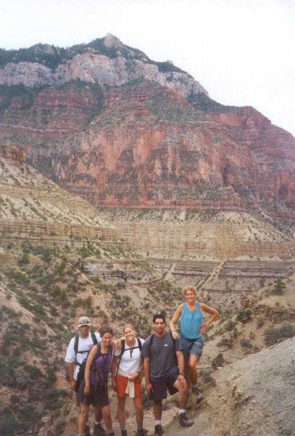Students and faculty pose in front of a canyon