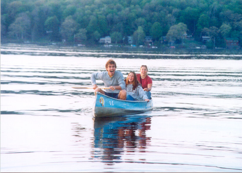 Bret Doverspike, Emily Toffic, and Liz Hoekwater canoeing on Canada Lake