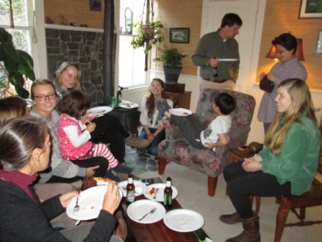 Clockwise from left, Amy Leventer, Hanah Berkovici (head turned), Meg Ryan with Julia Peck on lap, Maggie McGuire, Kate Hardock, William Peck, Henry Peck (in chair), Myongsun Kong, and Annie Preston, enjoy good company and good food in the den
