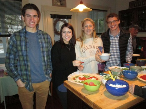 Seamus Crowley, Grace Howard, Natalie Smith, and Alex Taylor working on their pizza creation