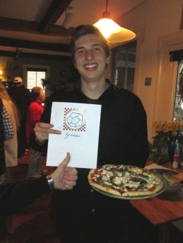 "Rich April gives a ""thumbs up"" to Oleg Kozel's Pyritohedron Pizza."