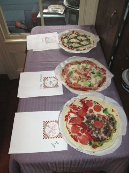 Oleg's Pyritohedron Pizza, Jeff & Tom's Transform Fault Pizza, and Nat & Ciara's Volcano Pizza wait for their turn in the oven.
