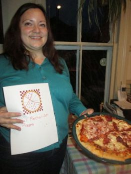 Geophysics professor, Aubreya Adams, presents her Focal Mechanism Pizza.