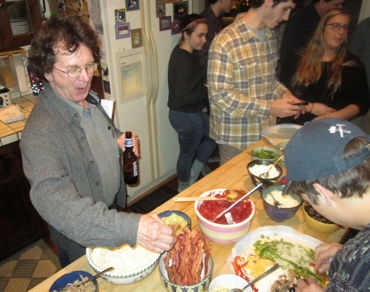 "Something tells me that piece of bacon never made it onto a pizza... Dave Linsley, enjoying the ""hors d'oeuvres."""