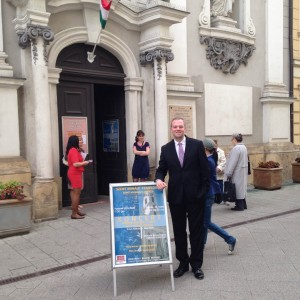 Ryan Endris (Director of Choral Activities) in front of our final concert venue, St. Michael's Church in Budapest.