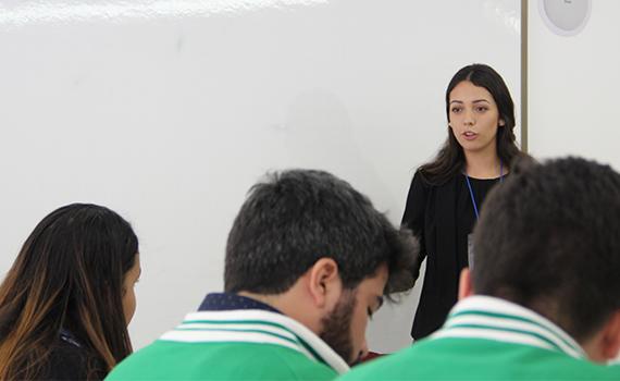 Colgate student Valeria Felix participates in a debate round at CMUDE 2015.