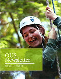 Student researcher descends from the rain forest canopy in a harness