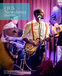 Cover of the December newsletter with a student playing guitar