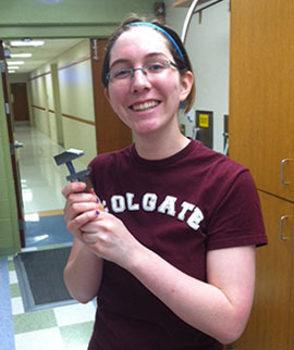 Carrie Burgess '14 shows the monkey wrench that she made herself