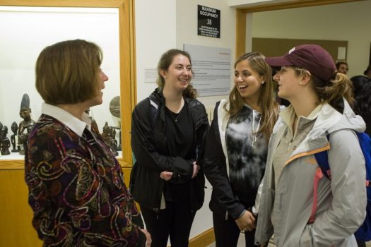 Professor Moran speaks with a group of students at the exhibition opening.