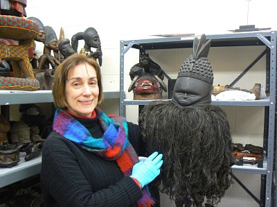 Professor Mary Moran with an African mask from the Longyear Museum collections.