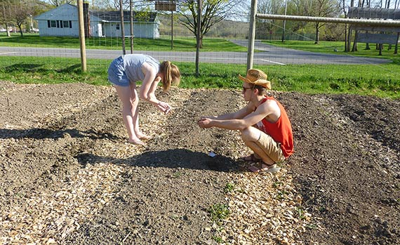 Two students working to plant the Community Garden at Colgate.