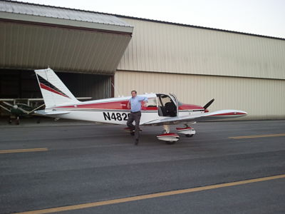 Paul Fick poses with his plane