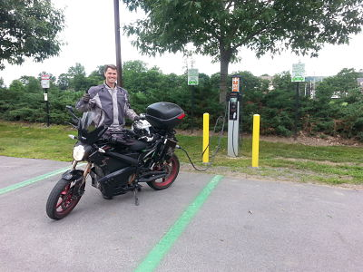 Ben Rich '99 charging his electric motorcycle at Colgate.