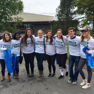 Green Ambassadors encouraging recycling during the homecoming tailgates this weekend, sporting their SustainU Green Raider Shirts.