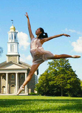 Danielle Iwata '15 dancing in front of Memorial Chapel at Colgate