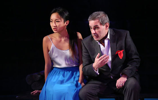 Christina Liu '13 on stage with another actor