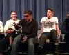 Members of the Pig Iron Theater Company sit on the edge of the stage in Brehmer Theater and address questions from students.