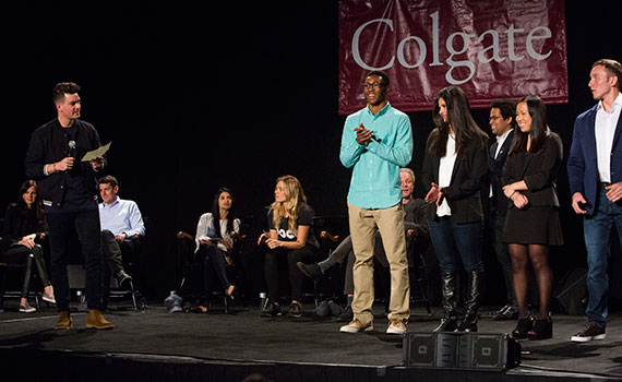 Thought Into Action students gather on stage at Colgate's fifth Entrepreneur Weekend celebration. (Photo by Gerard Gaskin)