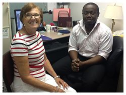 Albert Boateng '14 and Diane Ryan at Community Action Partnership in Madison County