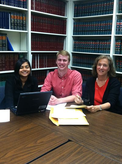 Crystal Sawh and Will Ely work with Attorney Susan Conn at the Legal Aid Society of Mid New York office in Utica.