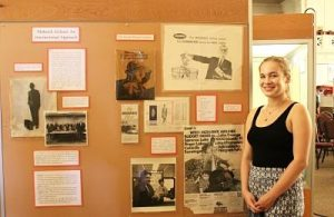 Erin Burke '18 with part of her finished exhibit at the society