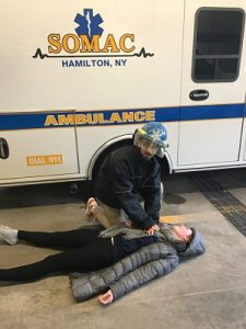 Nezar Mehanna helps a student in front of an ambulance